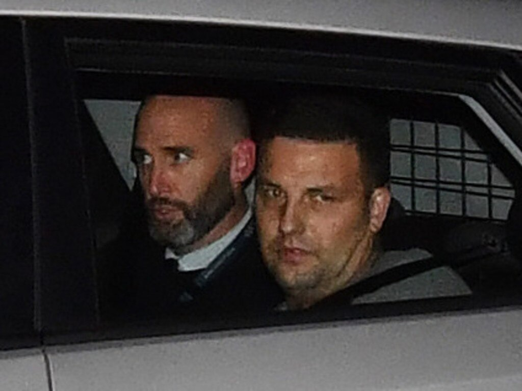Zlatko Sikorsky (right) is seen in a police vehicle arriving to Maroochydore Police Station on June 30, 2018. Sikorsky, 34, was arrested after a 27-hour siege at Alexandra Headland. Photo: Darren England