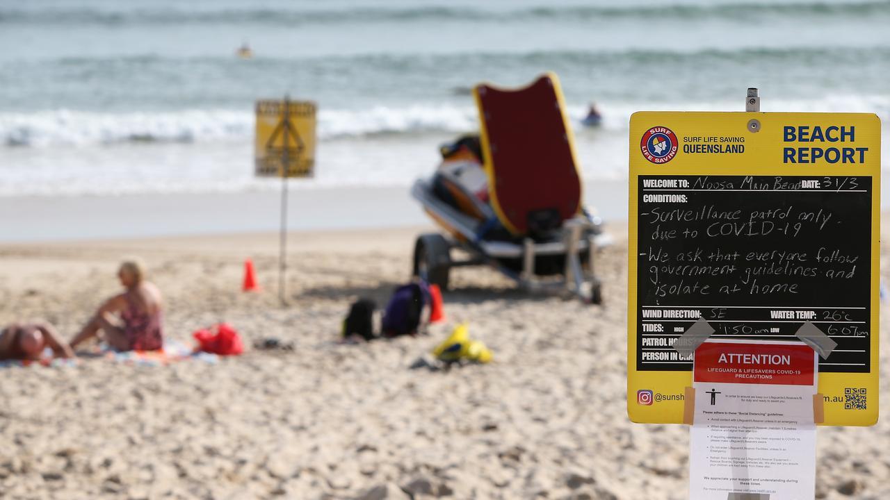 WARNING: A SLS Queensland COVID-19 alert sign at Noosa Main Beach. Photo: Lisa Maree Williams/Getty Images