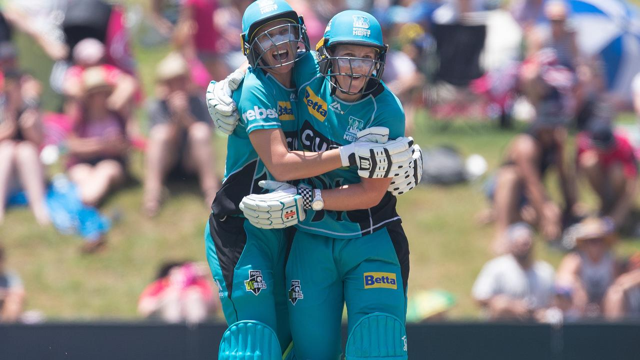 Delissa Kimmince and Laura Harris of the heat celebrate winning the match during the Women's Big Bash League (WBBL) final between the Sydney Sixers and the Brisbane Heat at Drummoyne Oval in Sydney, Saturday, January 26, 2019. (AAP Image/Steve Christo) NO ARCHIVING, EDITORIAL USE ONLY, IMAGES TO BE USED FOR NEWS REPORTING PURPOSES ONLY, NO COMMERCIAL USE WHATSOEVER, NO USE IN BOOKS WITHOUT PRIOR
