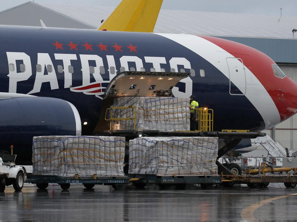 Palettes of N95 respirator masks are off-loaded from the New England Patriots football team's customised Boeing 767 jet at Logan Airport in Boston, after returning from China. Picture: AP