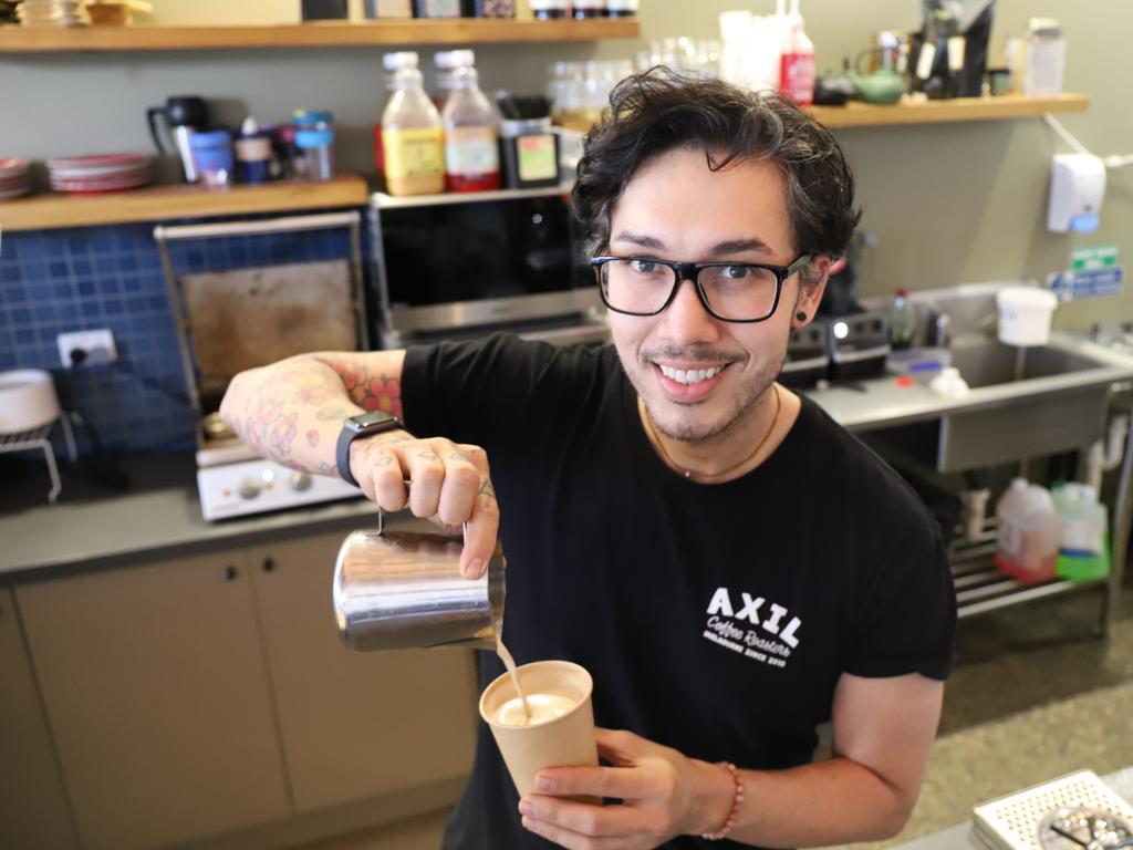 Adam Saron, at work at Woodman's Axe Espresso Mackay.