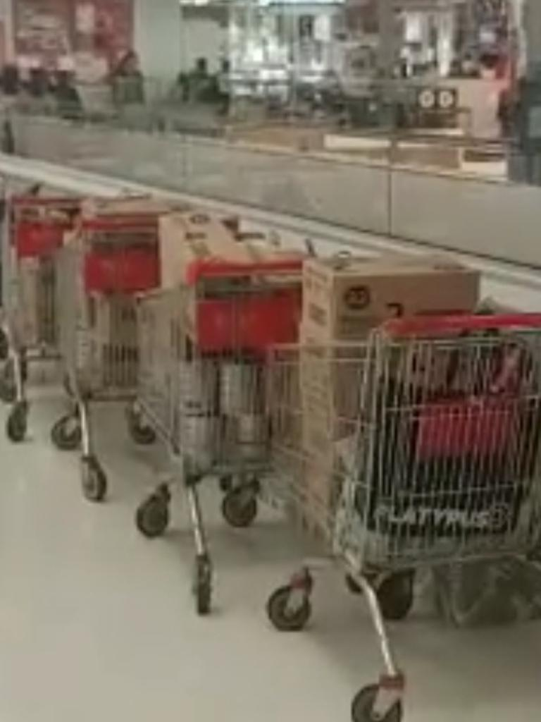At least five trolleys full of boxes of baby formula were lined up.