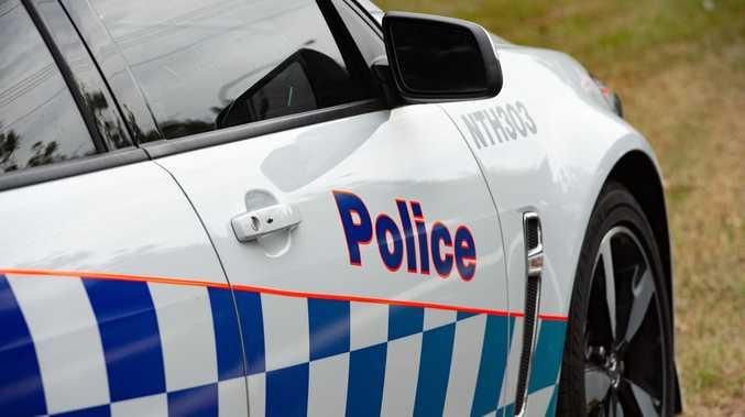 Man taken into custody at crash site