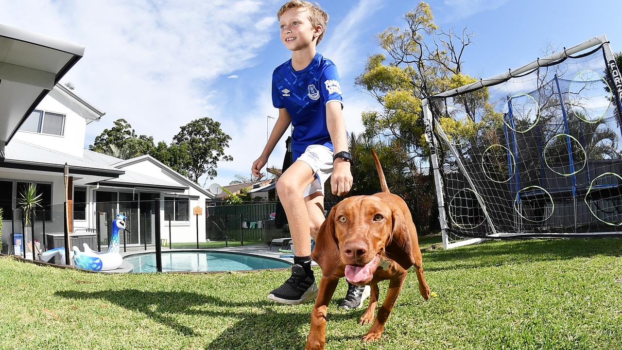 Billy Whyte, 10, ran 43km at home while stuck in self isolation because he wanted to complete a marathon. Awesome effort, he did it in 13 hours and only talk a half-hour break to watch Ice Age. Pictured with his four legged helper, Nova. Photo Patrick Woods / Sunshine Coast Daily.