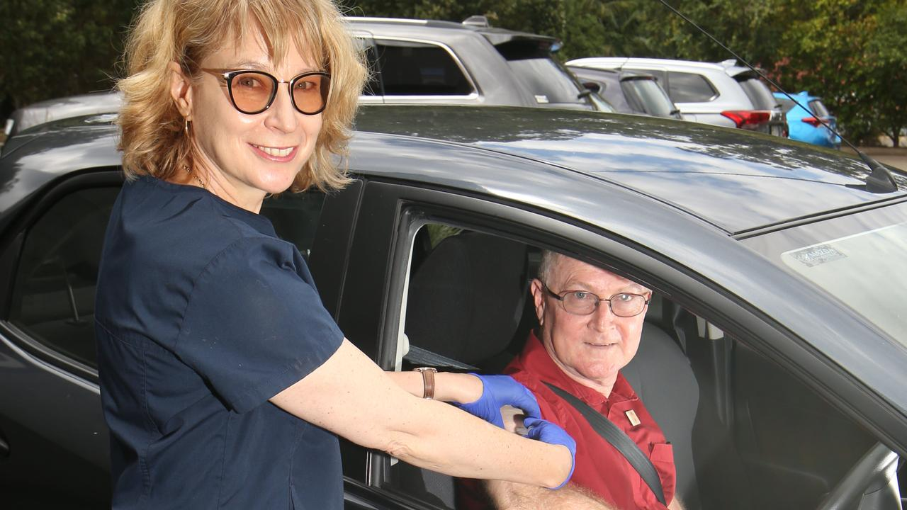 Tamborine Mountain Medical Centre. Dr Leeann Carr Brown giving a drive through flu vaccination to Tamborine local Ray Rose. Picture Glenn Hampson