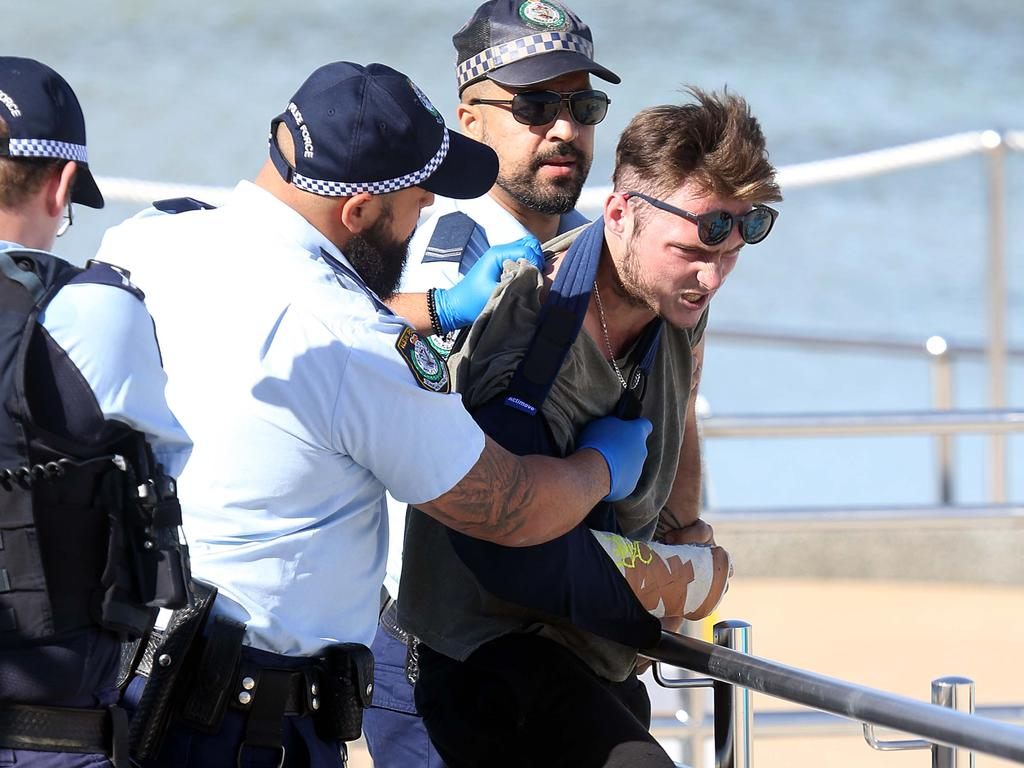 Photographs show a man was arrested at Bondi Beach this morning. Picture: Matrix