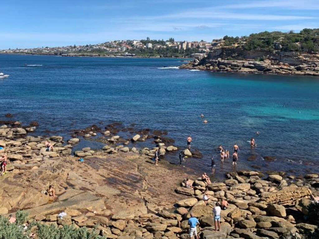Dozens of swimmers in the water near the Clovelly car park off the rocks in Gordon's Bay