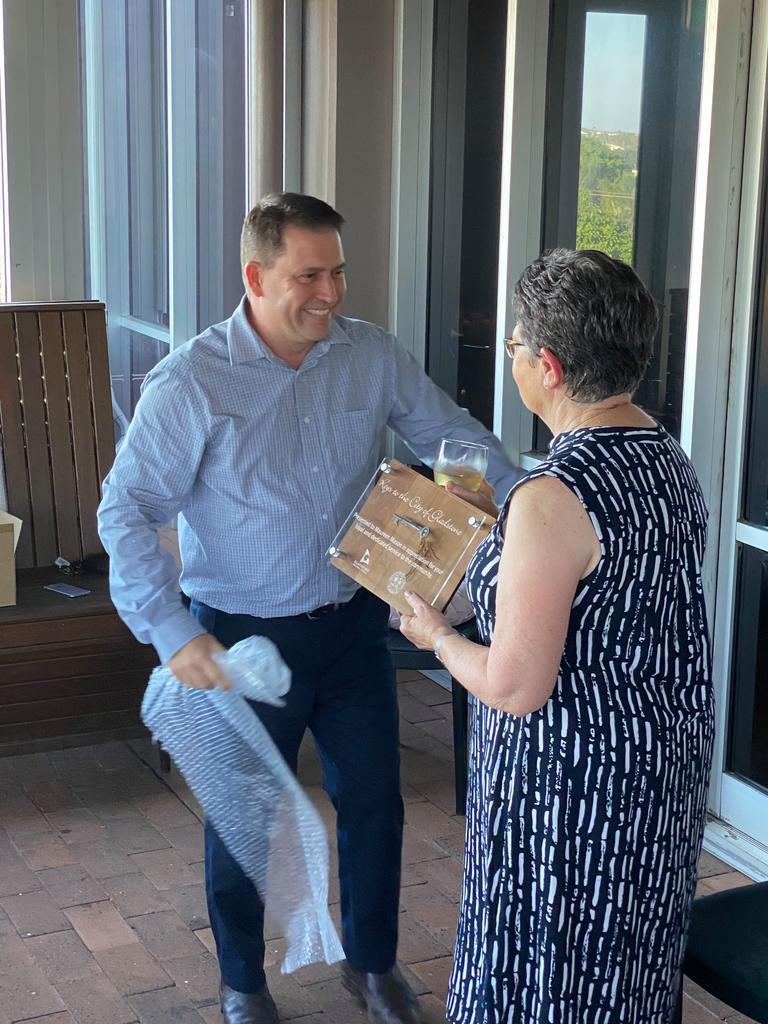 Mayor Matt Burnett presents the keys to Gladstone to retiring council worker Maureen Mason.