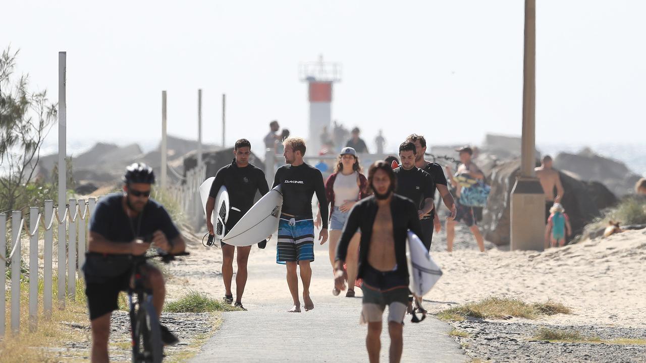 Packs of surfers ignored the warnings. Pics Adam Head