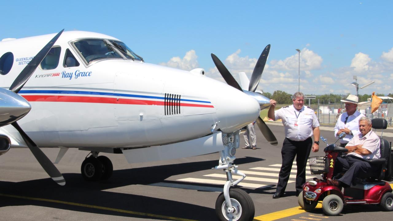 Ray Grace with an RFDS plane named in his honour.
