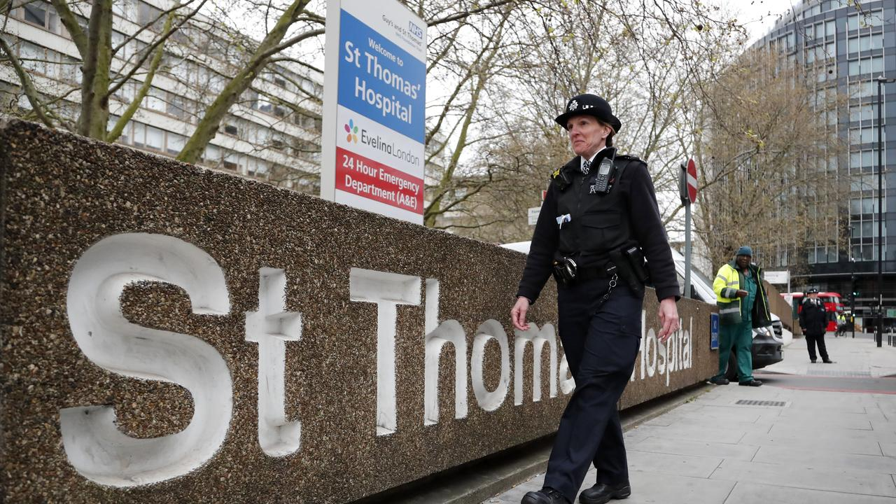 A police officer patrols outside a hospital where it's believed Boris Johnson is undergoing tests. Picture: Frank Augstein