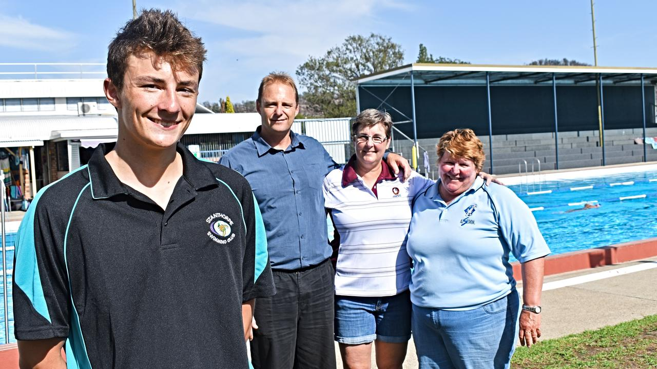 Ben Armbruster with dad Scott, mum Shannon and swimming coach Gail Smail.