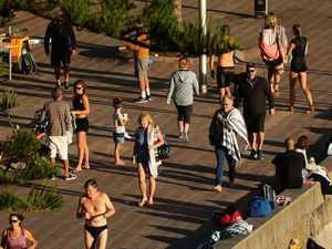 People flock to Manly Beach as it reopens