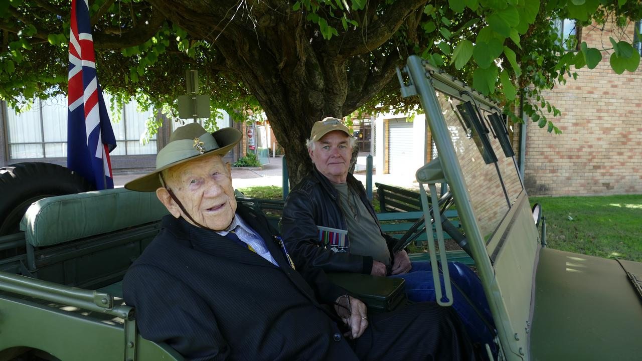 Henry 'Corky' Caldwell and driver Phil Heesch, pull up near the Cenotaph in Grafton's Memorial Park during his mini-Anzac Day parade in Grafton yesterday.