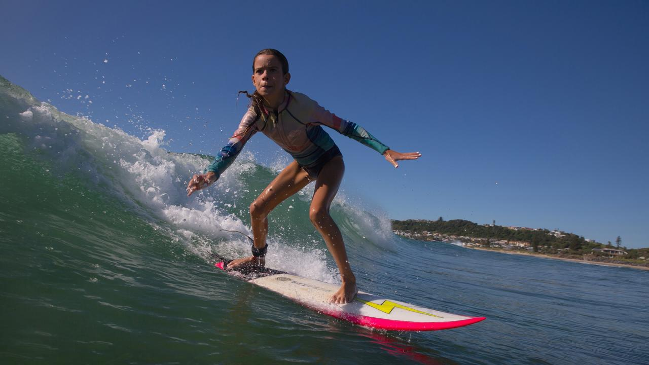 Mia Baker at her local beach. Don't take this away from us. Be smart with social distancing in the surf.