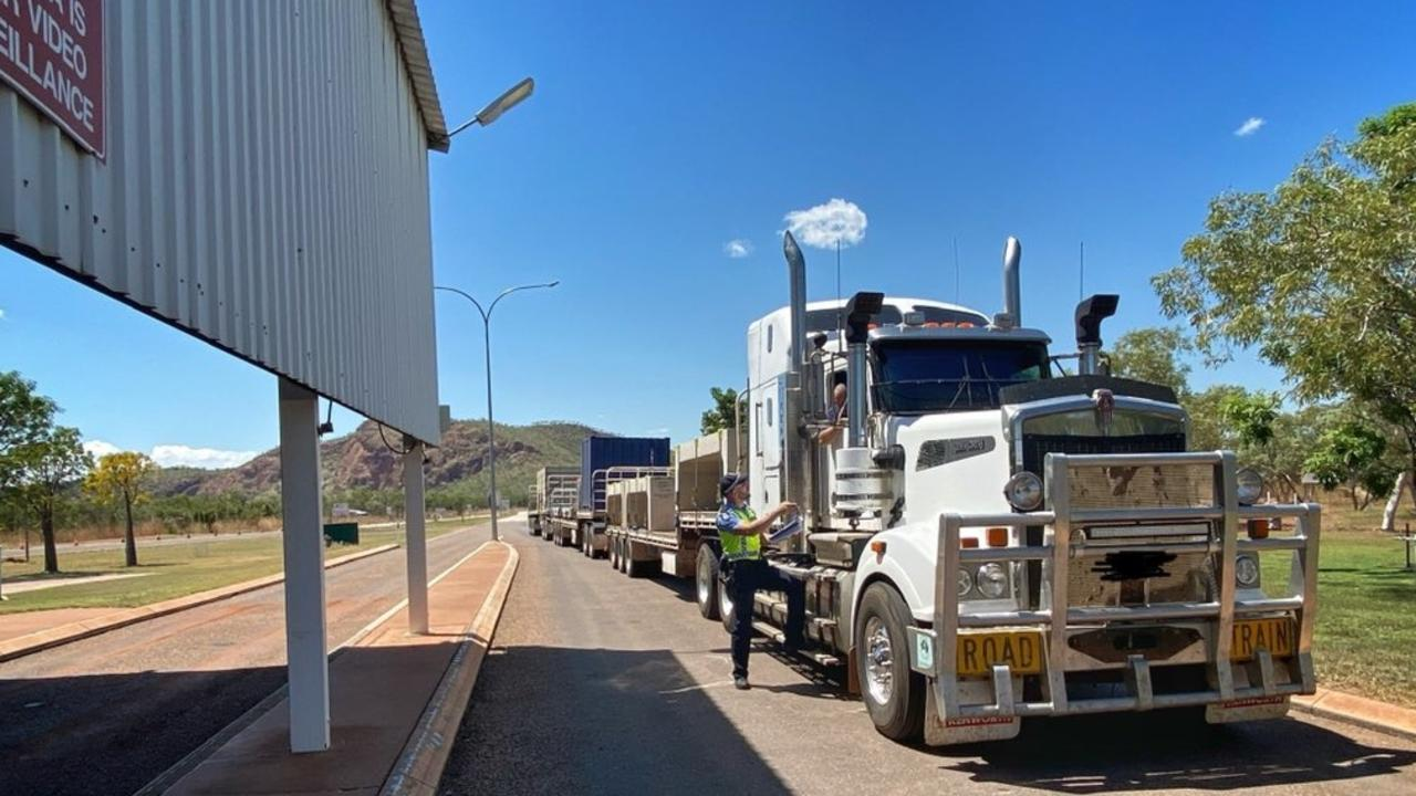 TRUCKIE ADVICE: Authorities say drivers passing through this WA/NT checkpoint have no need for concern after an officer there tested positive for the virus.