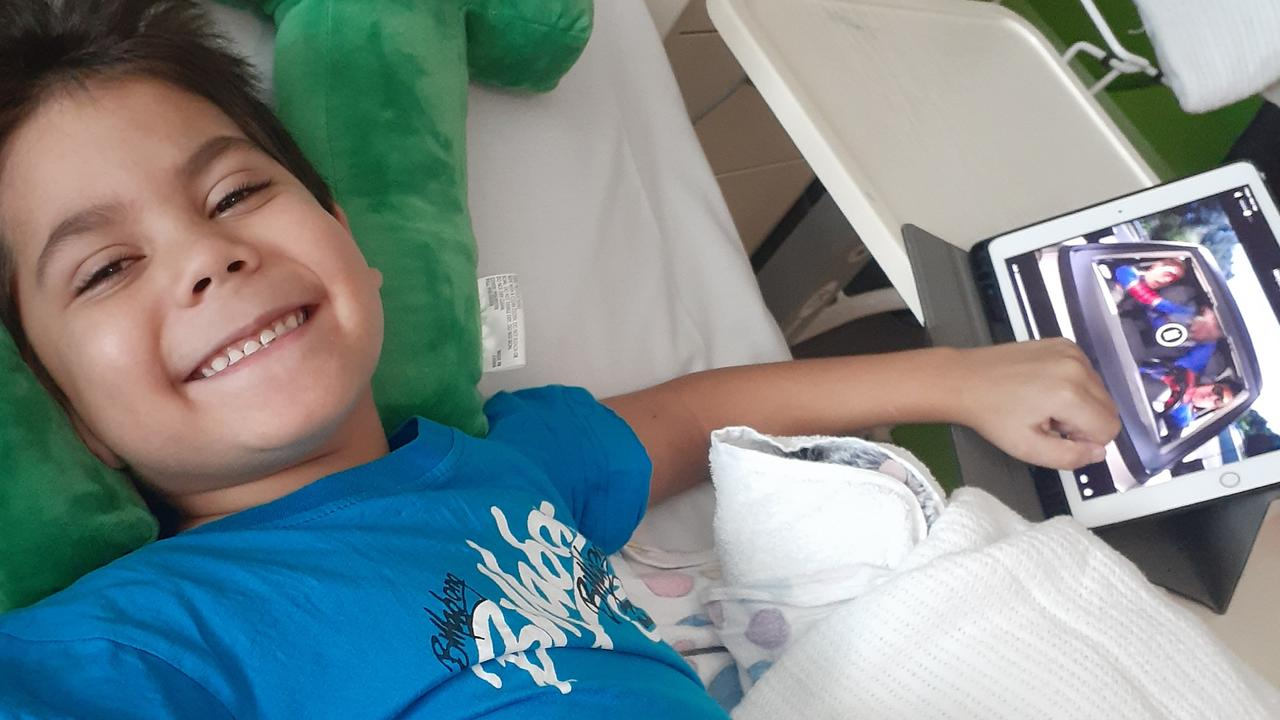 Emerald's Declan Burson, 7, was rushed to Brisbane Children's Hospital when he couldn't feel his legs. Doctors discovered a rare condition called spinal arteriovenous malformation (AVM) and after surgery deemed him a quadriplegic.