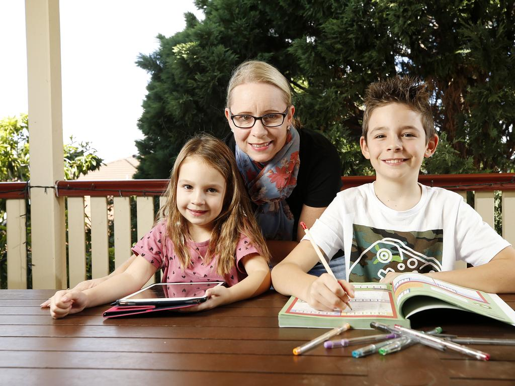 Amber Smith with Campbell, 8, and Amelia, 4, at home in Brisbane. Amber has been home schooling both kids since the schools closed due to the coronavirus. Picture: AAP