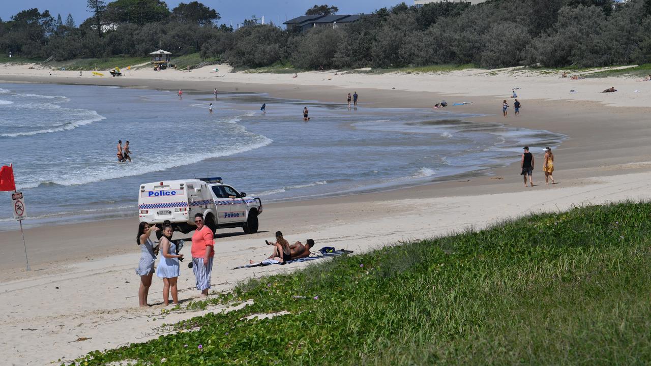 FINAL WARNING: Police car patrols Mooloolaba Beach. Photo: John McCutcheon