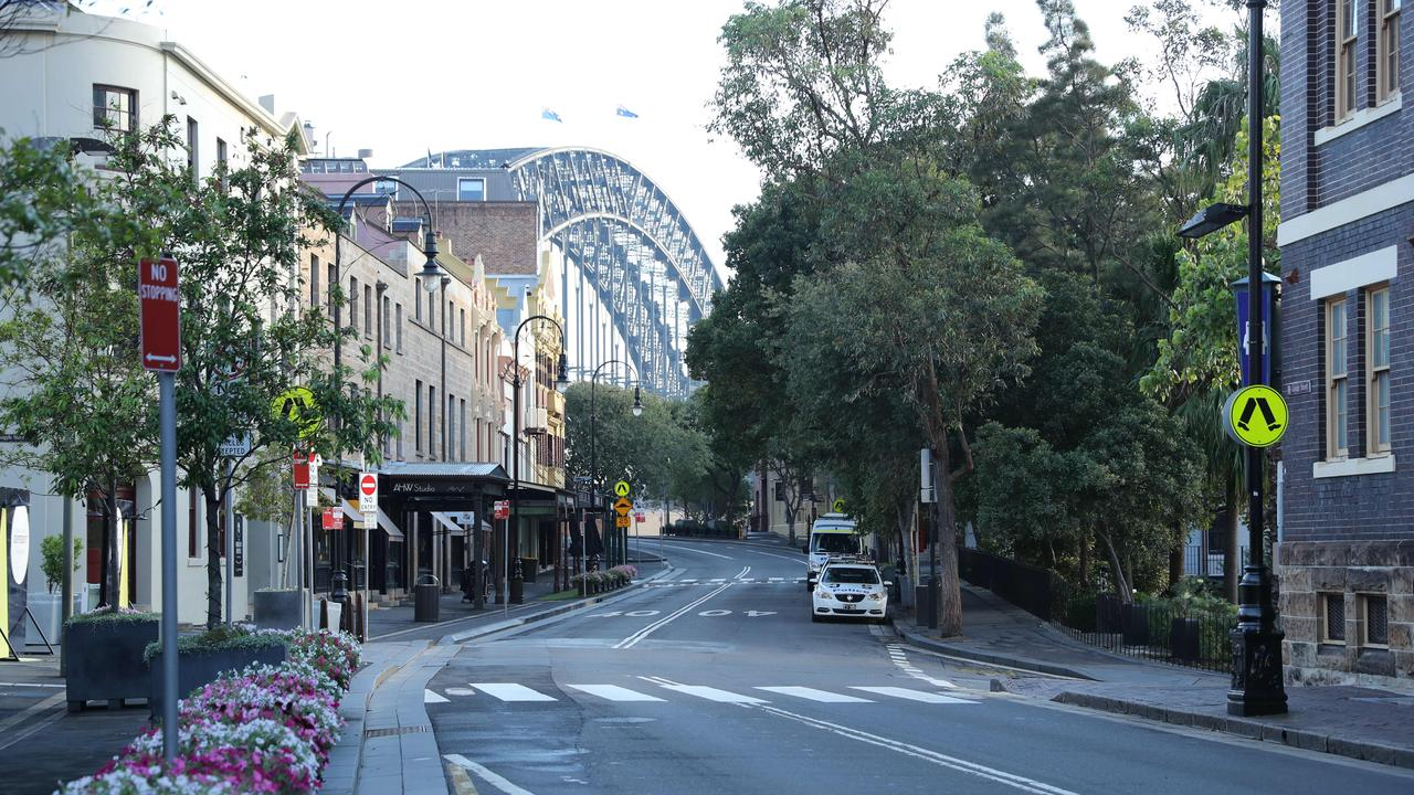 A nearly empty George Street in The Rocks, Sydney CBD. People are being asked to stay home and avoid any travel to try help stop the spread of Covid-19. Picture: Rohan Kelly