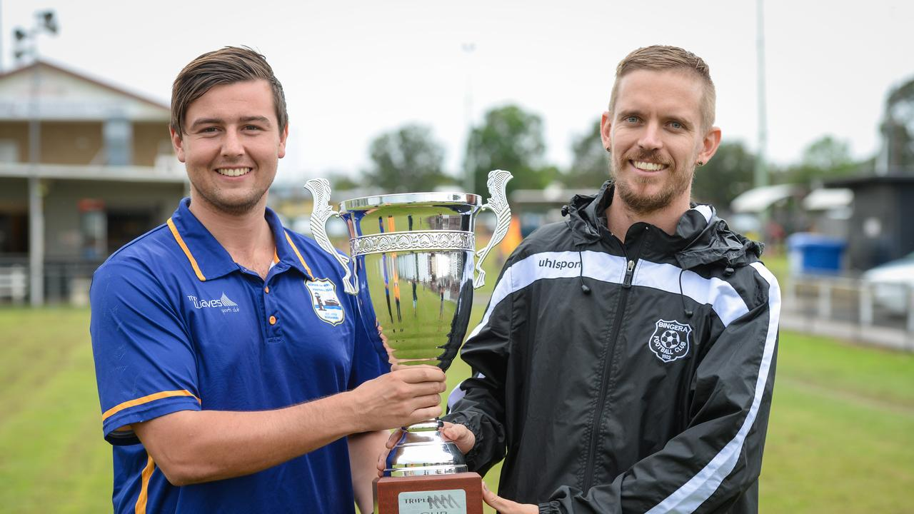 The Waves captain Callum Hillier with Bingera captain Daniel Watson with the Triple M Cup in 2019.