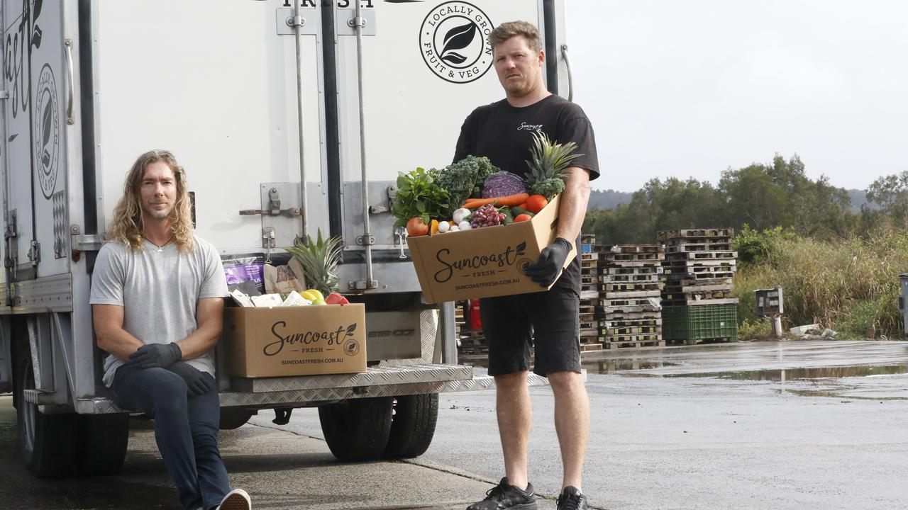 Bayleaf's Dan Readman and Suncoast Fresh manager Sam Johnson with goods for those in need.