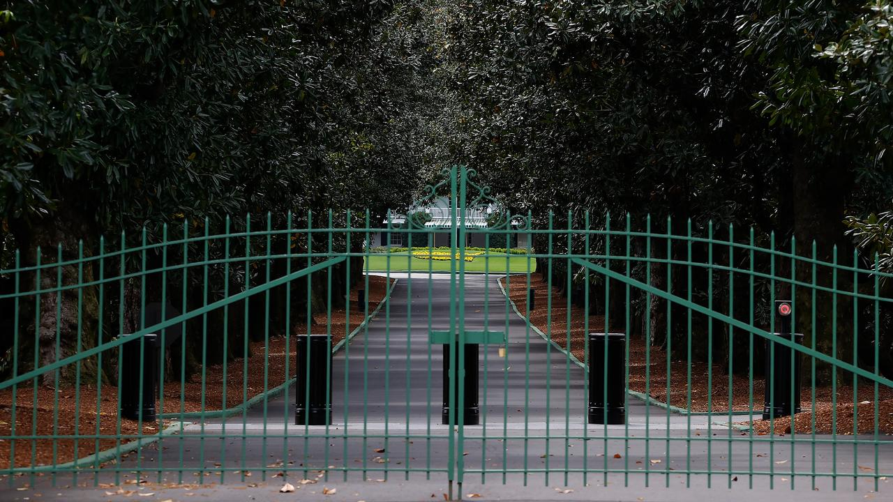 The gates will remain locked at the entrance of Magnolia Lane that leads to the clubhouse of Augusta National due to the coronavirus pandemic. Picture: Kevin C. Cox/Getty Images