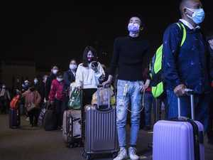Thousands flee Wuhan in droves as lockdown is lifted