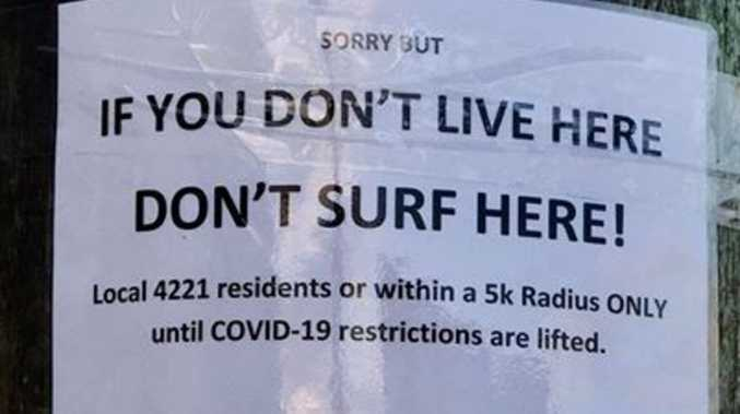 'Locals only' signs appear at Qld beach