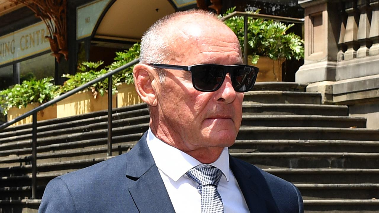 Chris Dawson leaves the Downing Centre Local Court in Sydney.