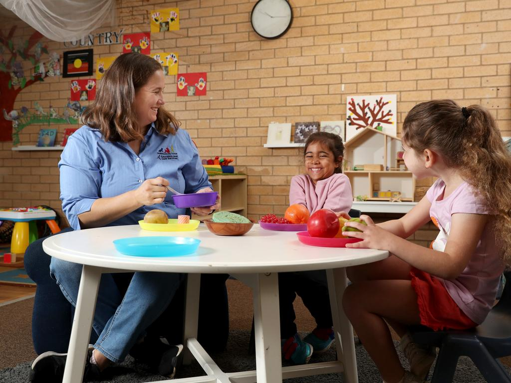 Teacher Rebecca Gibbs with Charlotte, 4, and Sienna, 4, (right) at Amber Cottage Early Learning Centre in Ambarvale. Picture: Jonathan Ng