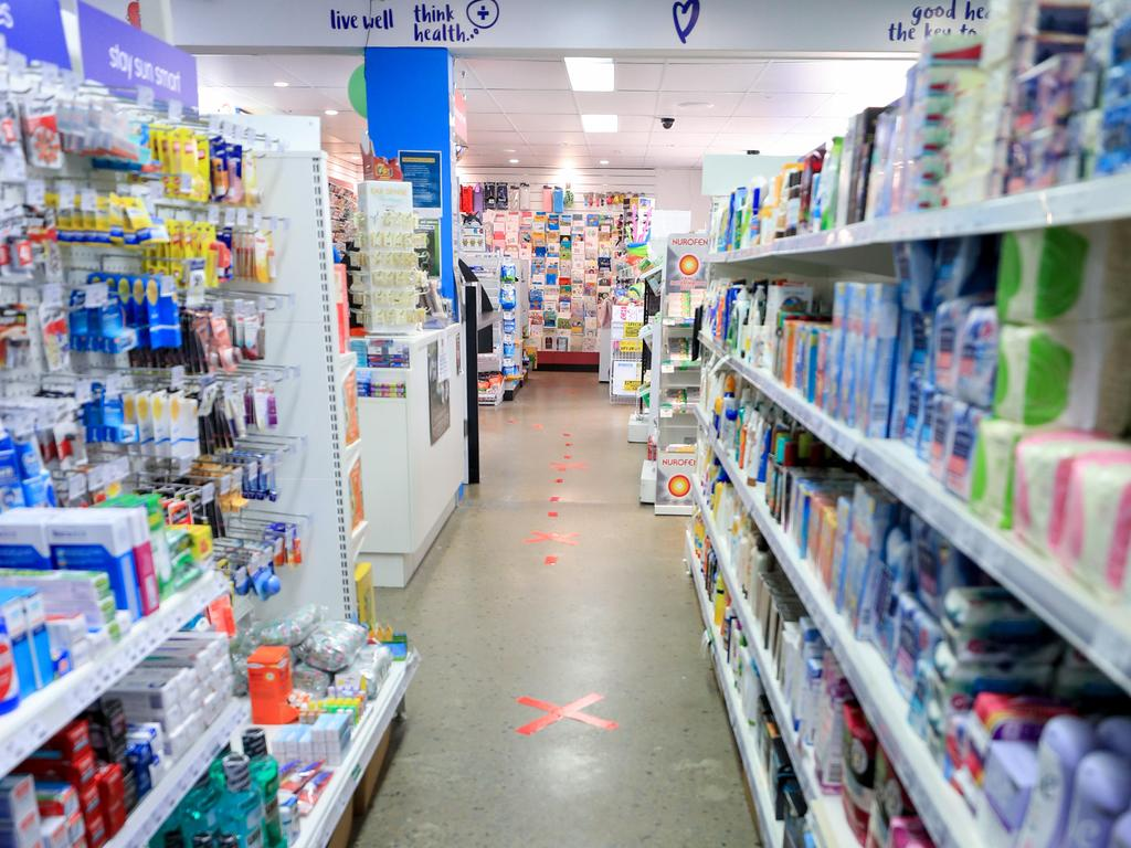 Chemists like this one on the Gold Coast have introduced markings on the ground for customers to follow when queuing in line with social distancing measures. Picture: Tim Marsden