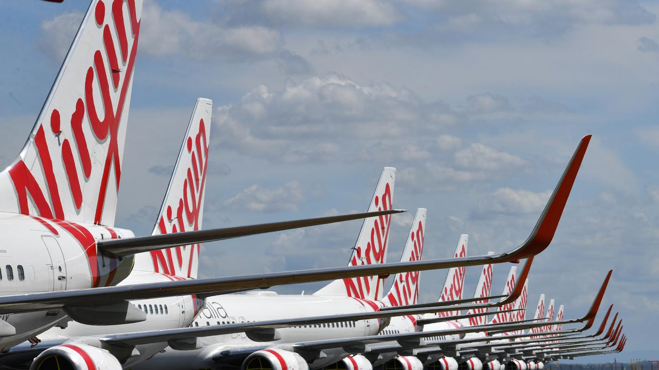 Grounded Virgin Australia aircraft are seen parked at Brisbane Airport. Picture: Darren England