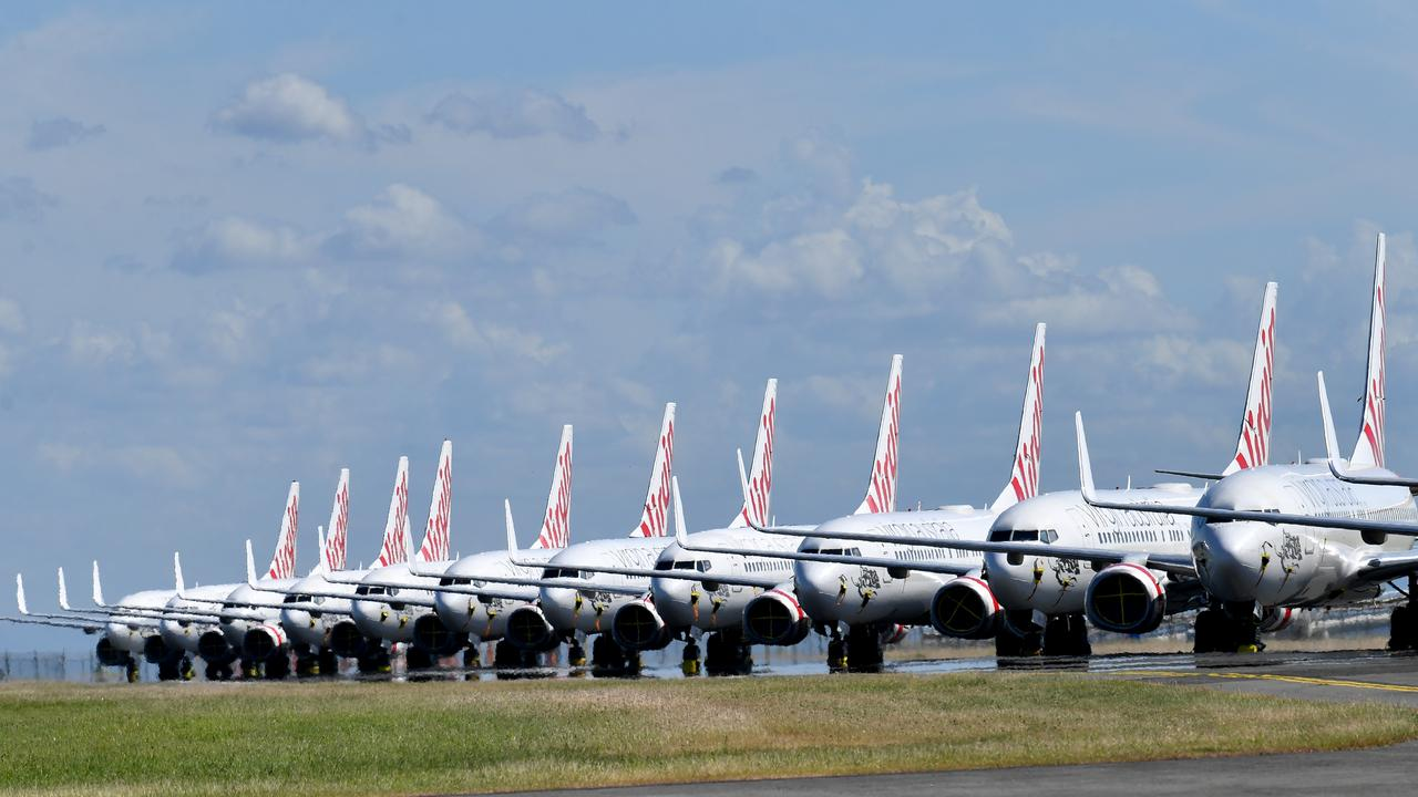 Grounded Virgin Australia aircraft line the Brisbane Airport runway. Picture: AAP Image/Darren England