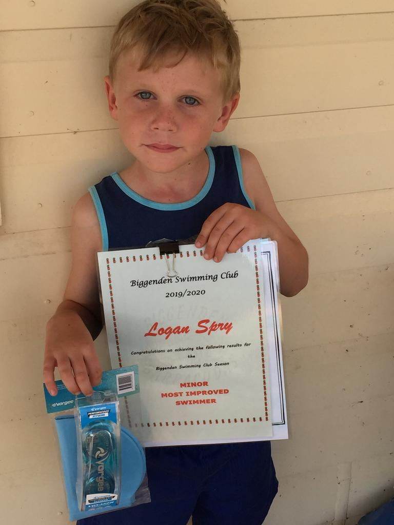 Logan Spry shows off his certificate for most-improved swimming in his group at the Biggenden Swimming Club.