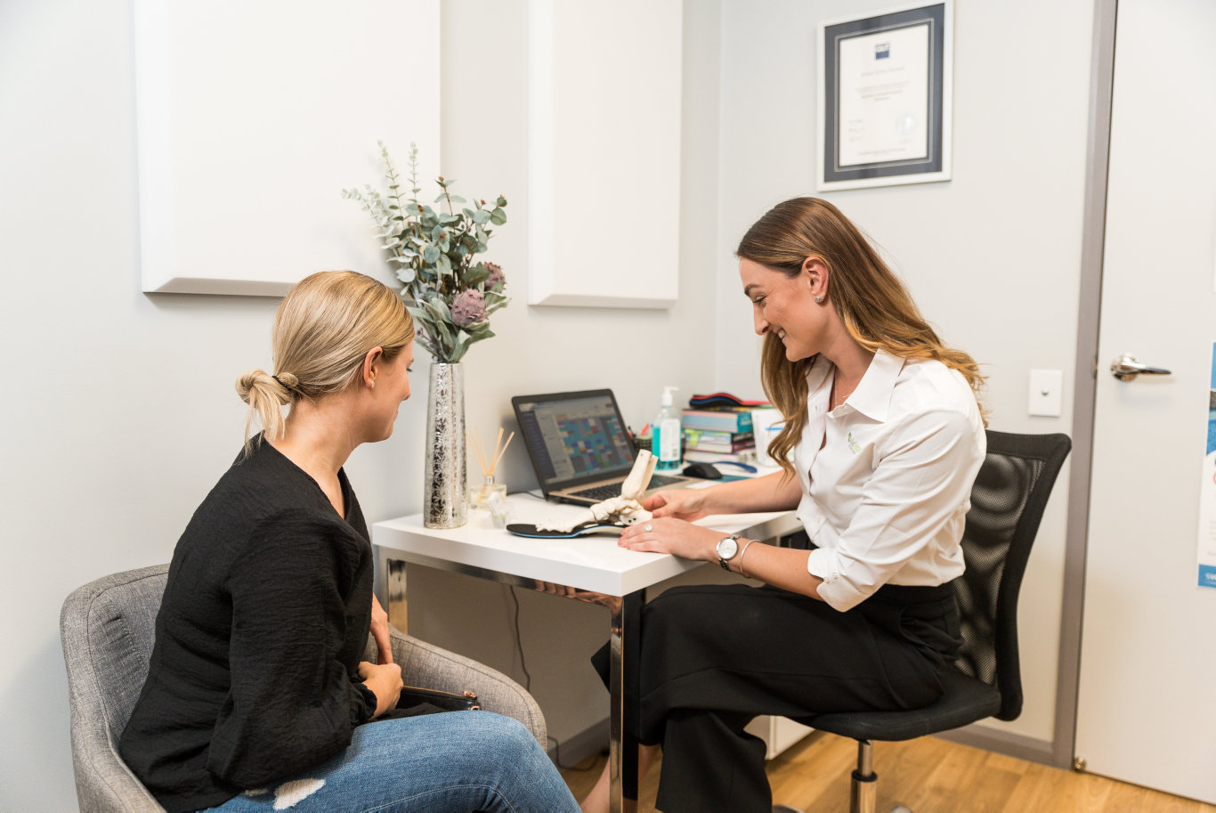 Owner & Head Podiatrist at Sole Focus Podiatry, Jessica Hannah, with a client