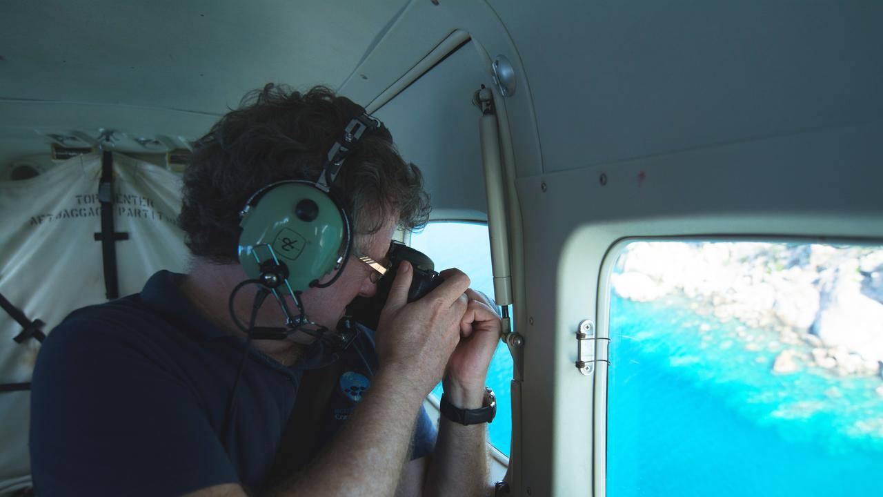 Director of the ARC Centre of Excellence for Coral Reef Studies Professor Terry Hughes conducting a previous coral bleaching aerial survey in 2017. Photo: Ed Roberts