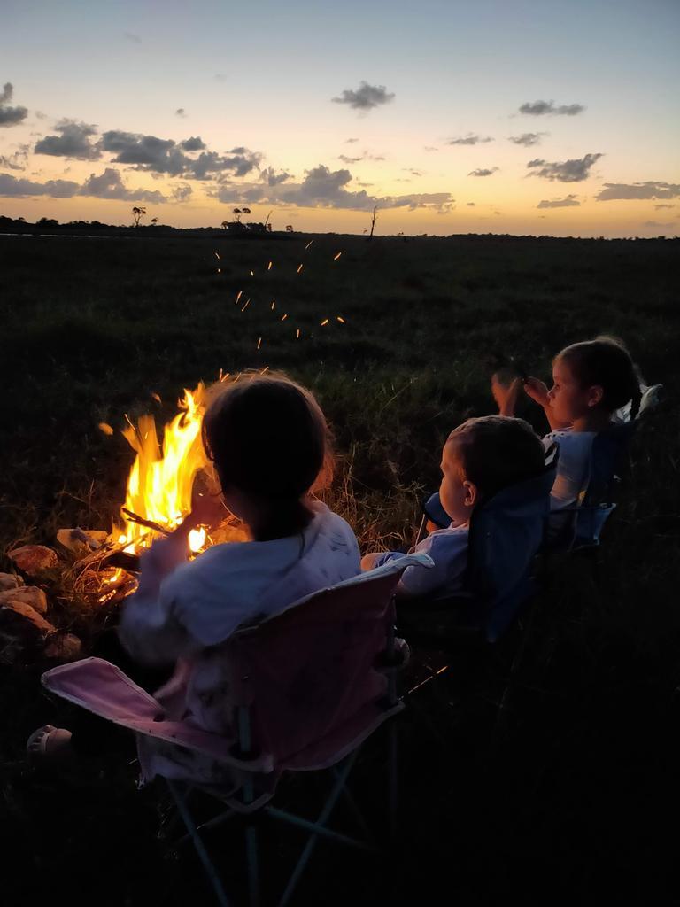 Farmer's children around campfire. PHOTO: Contributed