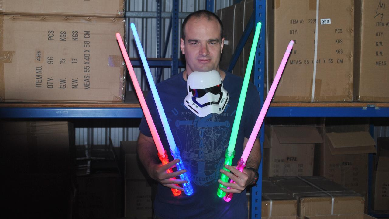 BUSINESS OPEN: Glow Productions warehouse manager Zane McLachlan with some of the flashing novelties available to the public.