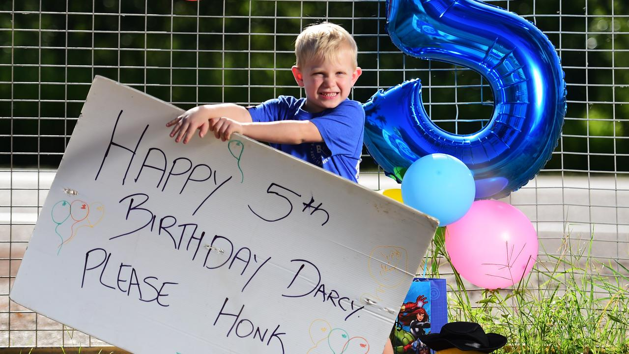 Darcy Campbell is celebrating his 5th birthday, so his mum Annie put out balloons and a sign for cars to honk as they pass by. Photo: Alix Sweeney