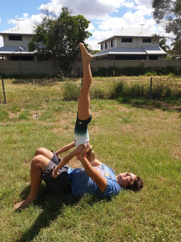 Evie working on her handstands with dad's help.
