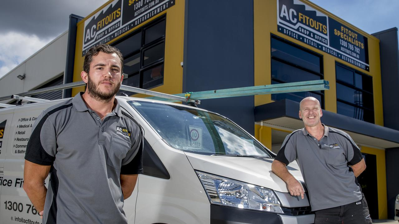 AC Fitouts in Upper Coomera has been given a four-month break from paying rent by its landlord. This means the business, combined with the JobKeeper subsidy, will be able to keep operating. Paul Langer and Neil Major at the Upper Coomera premises. Picture: Jerad Williams