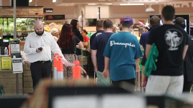 'Packed in': Aisles full as shoppers pour into Woolies