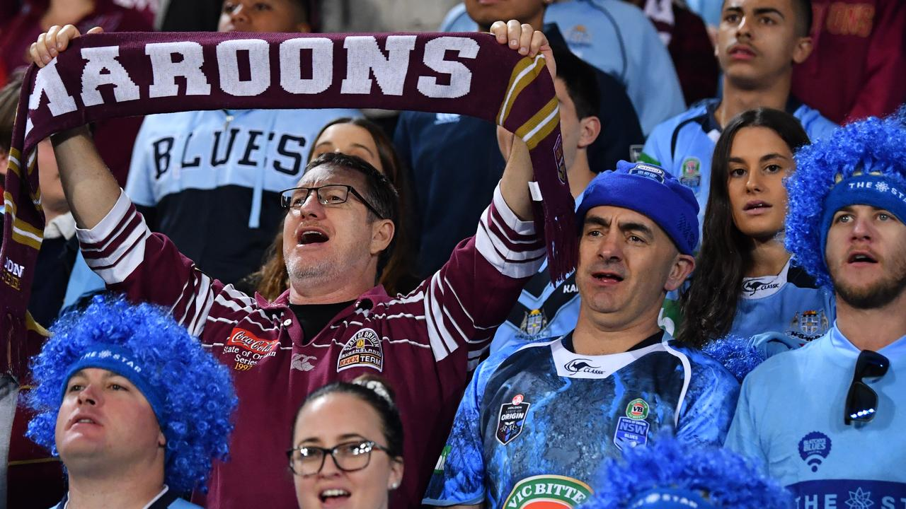 A Queensland fan among NSW supporters at Suncorp. Picture: AAP