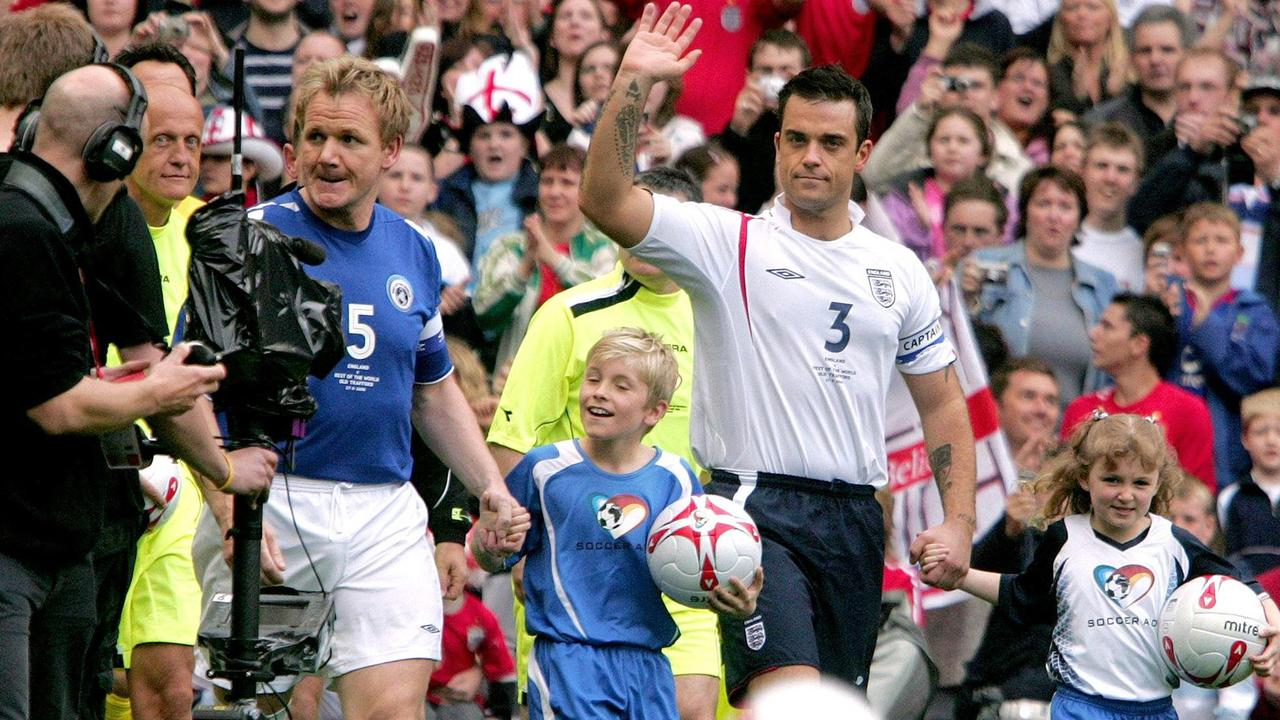 Ramsay with Robbie Williams in the England vs Rest of World UNICEF Aid charity match at Old Trafford in 2006.