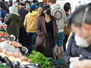 Huge crowds at Melbourne market spark outrage