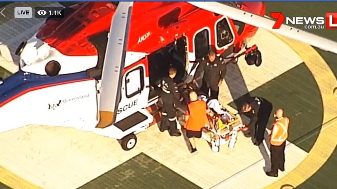 A bushwalker arrives at Princess Alexandra Hospital after falling and seriously injuring his pelvis at Tallebudgera Valley near Bonogin today. PHOTO: 7 NEWS FACEBOOK