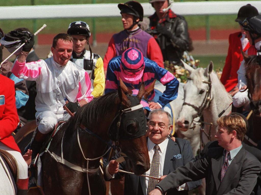 Owner Nick Moraitis leading Might And Power with jockey Jim Cassidy aboard after winning the 1997 Melbourne Cup.