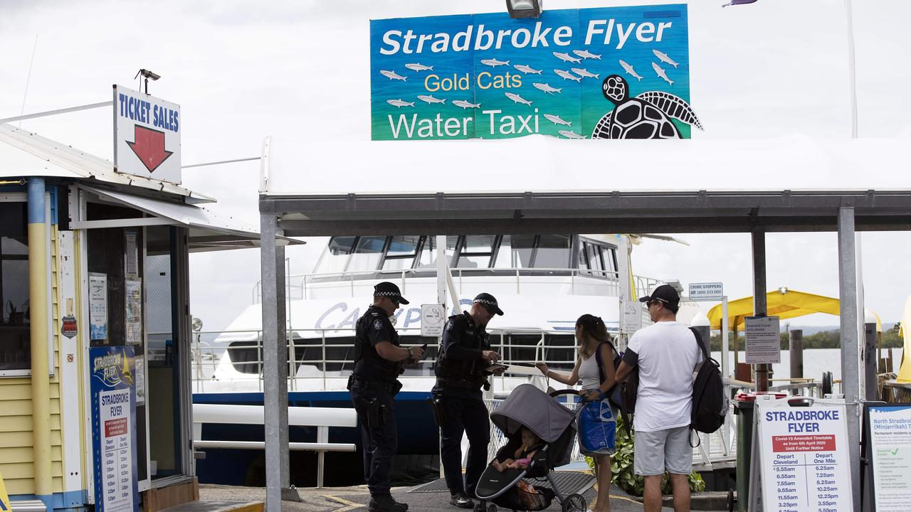 Police checking passengers for a Stradbroke Island ferry. Picture: Attila Csaszar/AAP