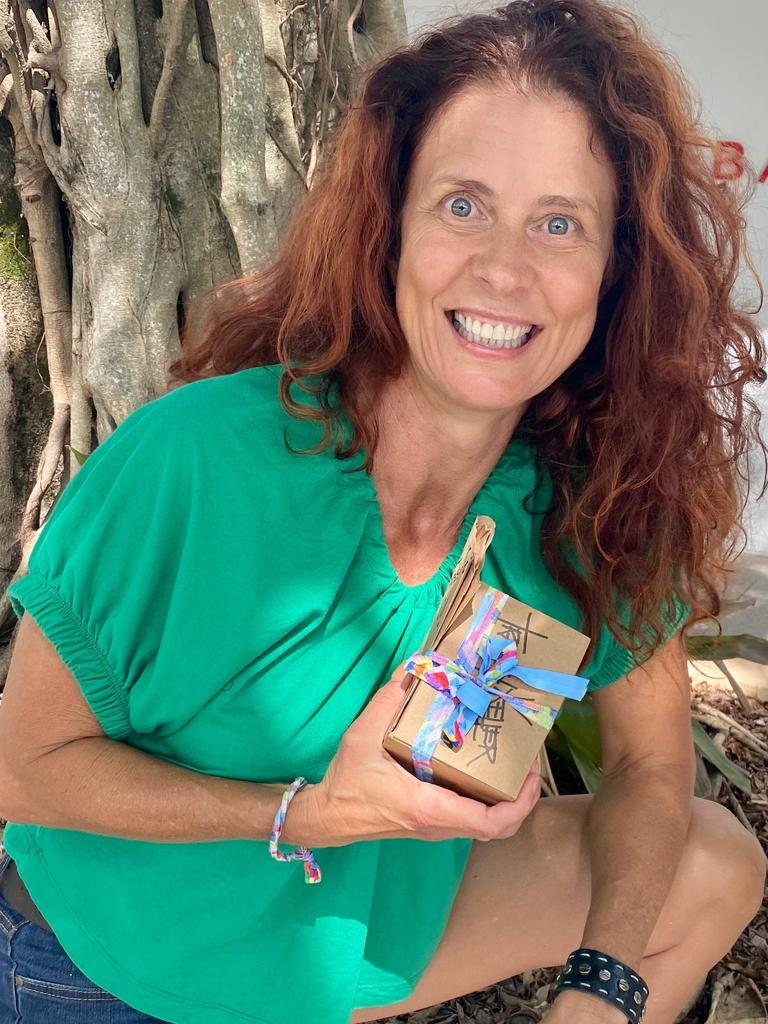 BRIGHT ACT: Noosa artist Tracey Keller has been leaving random acts of kindness along Hastings St to brighten the day of struggling shop owners and passers-by.